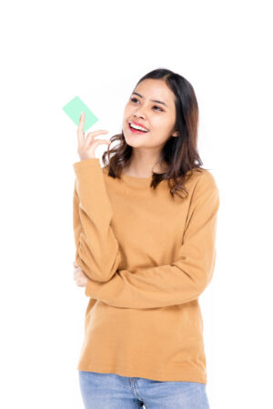 portrait of a beautiful woman asian teenagers showing my credit card with a confident happy face a confident beautiful woman on a white background